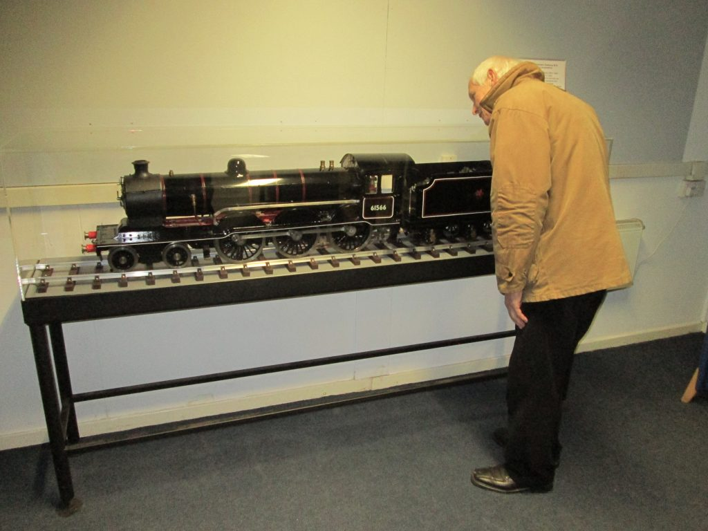 Clive Reynolds inspects his B12 locomotive on display in the museum building.