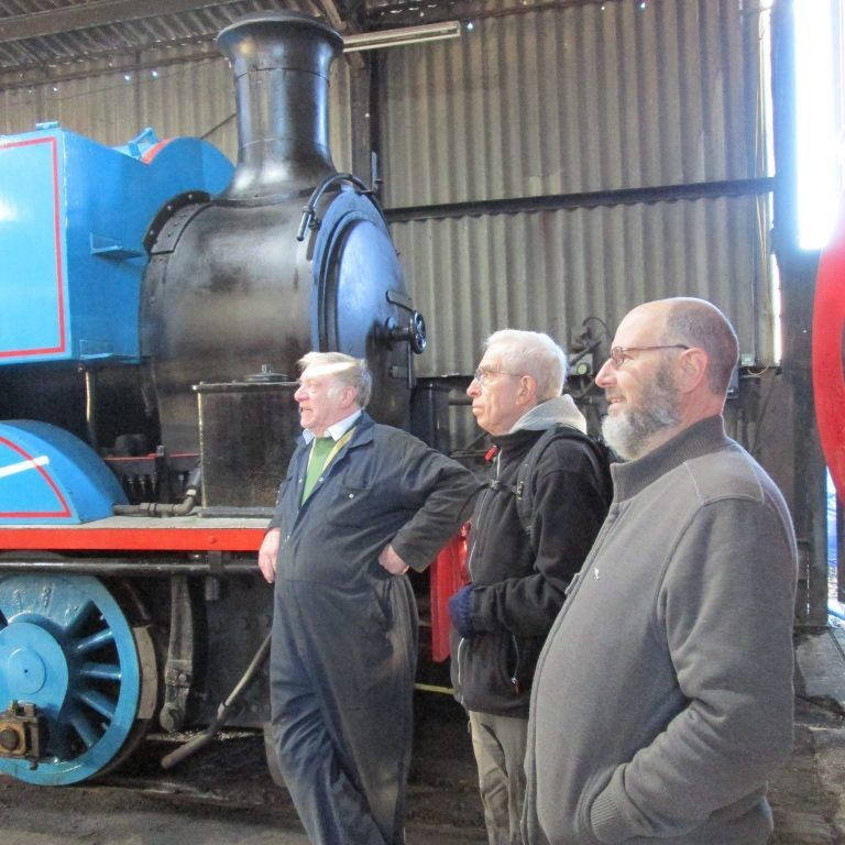 A museum volunteer, Dave Anderson and Neil Byrne enjoying a chat in front of Thomas the Tank Engine.